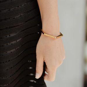 NIB Half United gold cuff